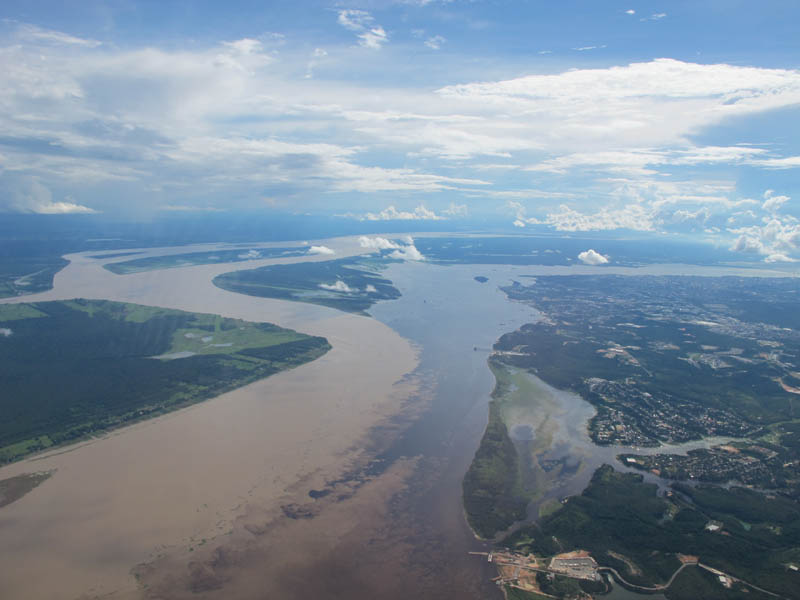 confluence of the rio negro black and the rio solimoes sandy near manaus brazil When Rivers Collide: 10 Confluences Around the World