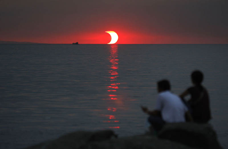 partial solar eclipse at sunset The Top 75 Pictures of the Day for 2012