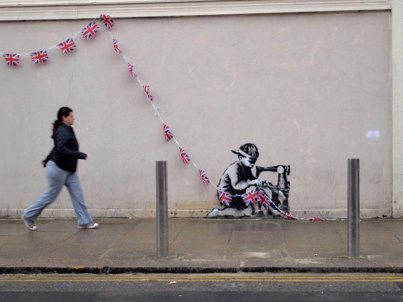 banksy boy sewing british flags street art stencil 1 10 Latest Artworks from Banksy