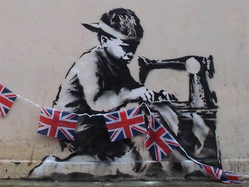 banksy boy sewing british flags street art stencil 2 10 Latest Artworks from Banksy