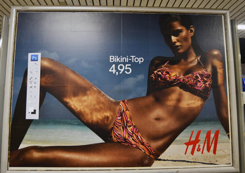 hm photoshop adbuster street art hamburg germany 1 Anonymous Street Artist Adds Photoshop Toolbar to H&M Billboards