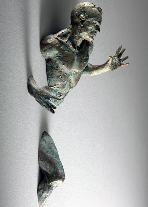 sculptures that emerge vanish into walls matteo pugliese 1 Amazing Sculptures That Emerge from Walls