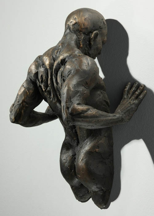 sculptures that emerge vanish into walls matteo pugliese 3 Amazing Sculptures That Emerge from Walls