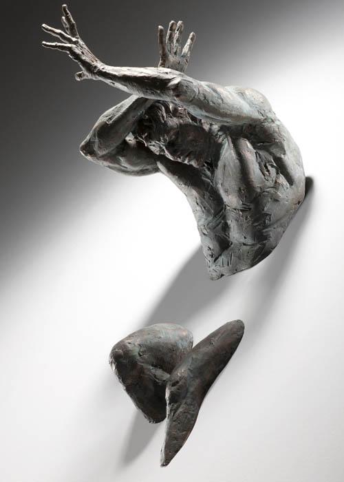 sculptures that emerge vanish into walls matteo pugliese 5 Amazing Sculptures That Emerge from Walls