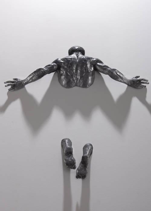 sculptures that emerge vanish into walls matteo pugliese 7 Amazing Sculptures That Emerge from Walls