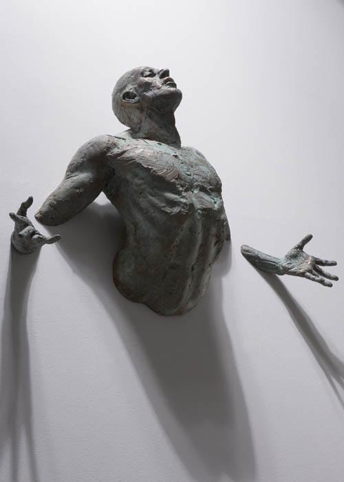 sculptures that emerge vanish into walls matteo pugliese 8 Amazing Sculptures That Emerge from Walls