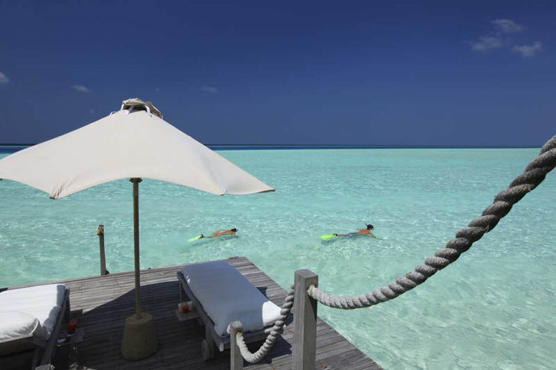 snorkeling from villa private deck copy The Amazing Stilt Houses of Soneva Gili in the Maldives