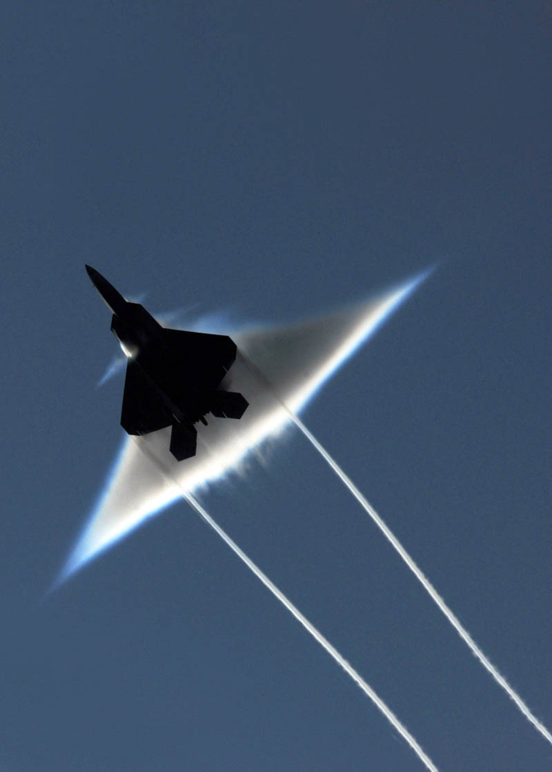 airplane breaking the sound barrier looking from below