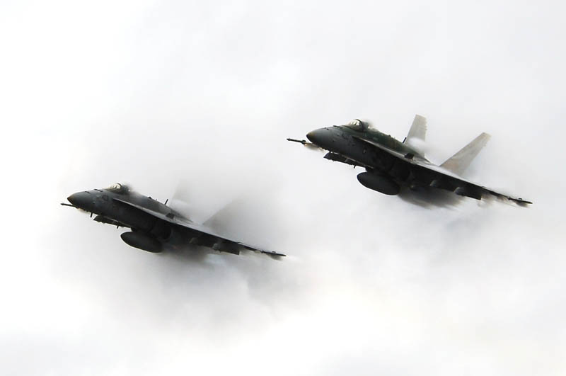 two planes side by side breaking the sound barrier