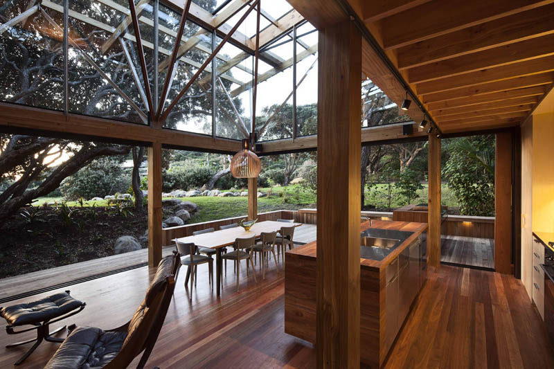 shot of outdoors and kitchen beach house new zealand