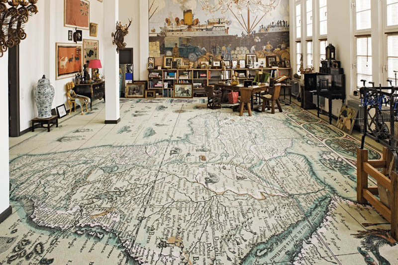 room with map floor, africa printed onto very large carpet that covers entire floor