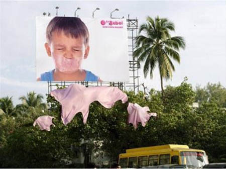 billboard for bubble gum shows gum all over trees from big bubble