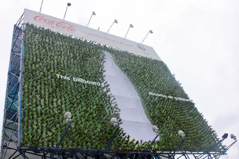 green billboard with plants to suck up carbon coca cola