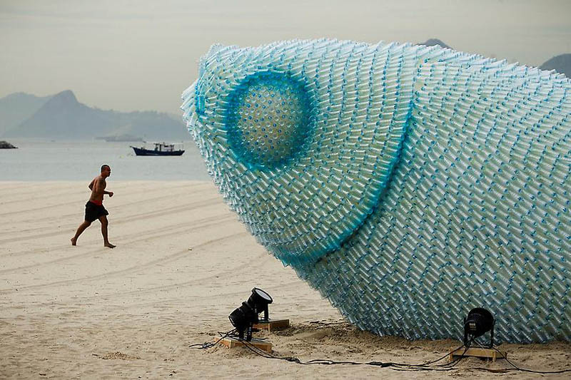closeup shows the thousands of plastic bottles used to create giant fish sculptures to raise awareness for oceans