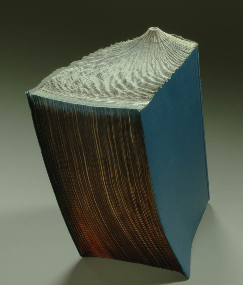 volcano carved into top of book pages