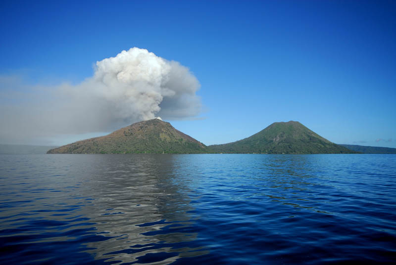 Mount Tavurvur of Rabaul caldera papa new guinea spewing ash with dormant volcano right beside