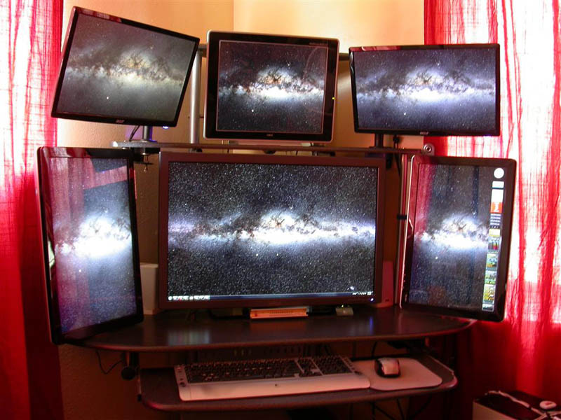 six monitor computer station set up all tiled inwards The Undersea Cables that Connect the World