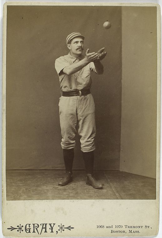 baseball player sid farrar about to catch a baseball barehanded