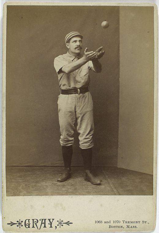 baseball player sid farrar about to catch a baseball barehanded