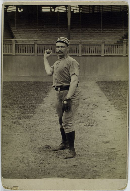 Deacon McGuire, Philadelphia Quakers posing for baseball photo about to throw a ball