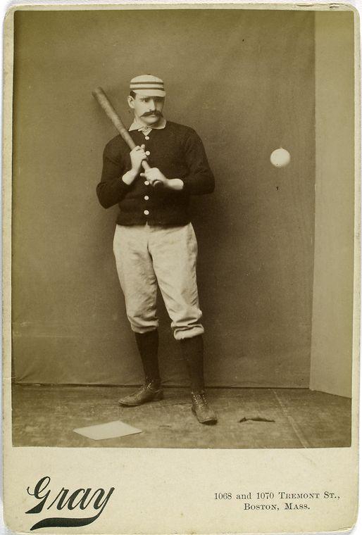joe mulvey looking at baseball with bat in hand