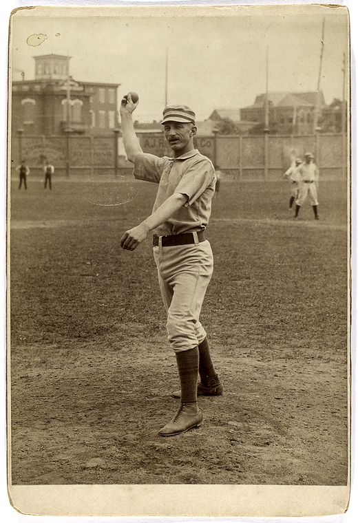 Charlie Buffinton about to pitch a baseball