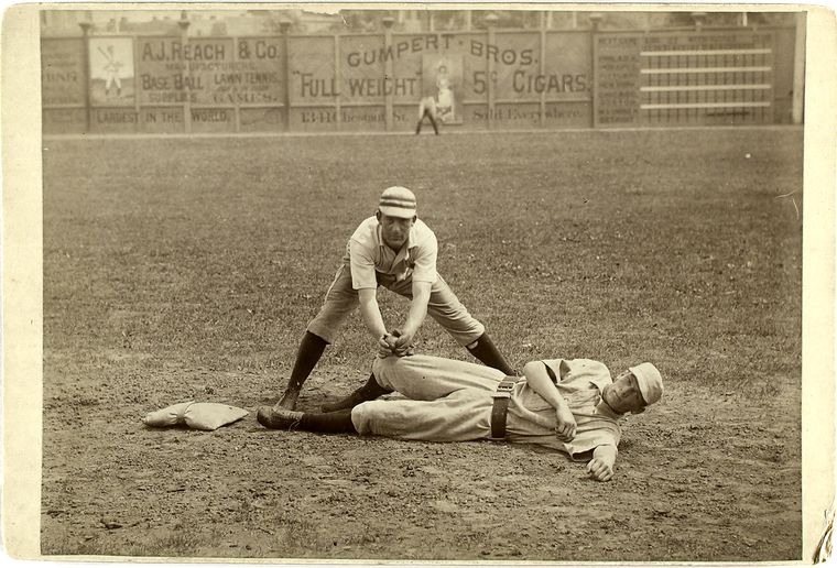 Charlie Bastian and Denny Lyons vintage baseball photo sliding into second candidly