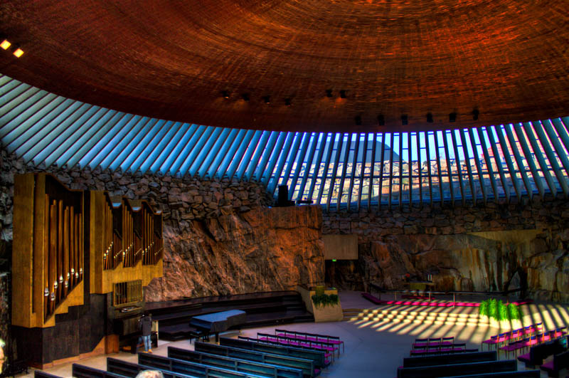 interior shot of the Temppeliaukio Rock Church in helsinki finland from the balcony during the day