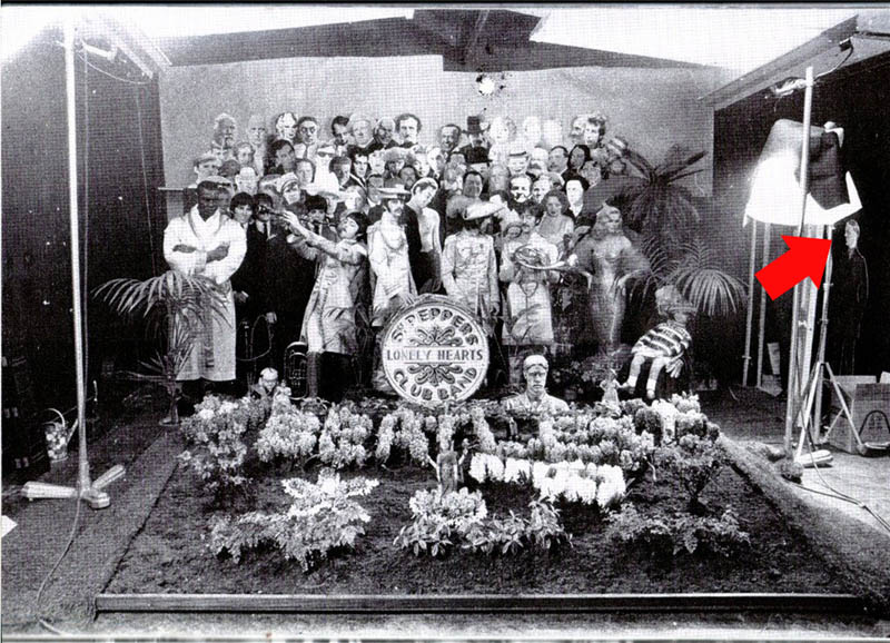 studio shot of the sgt. pepper album cover by the beatles shows hitler cutout off to side
