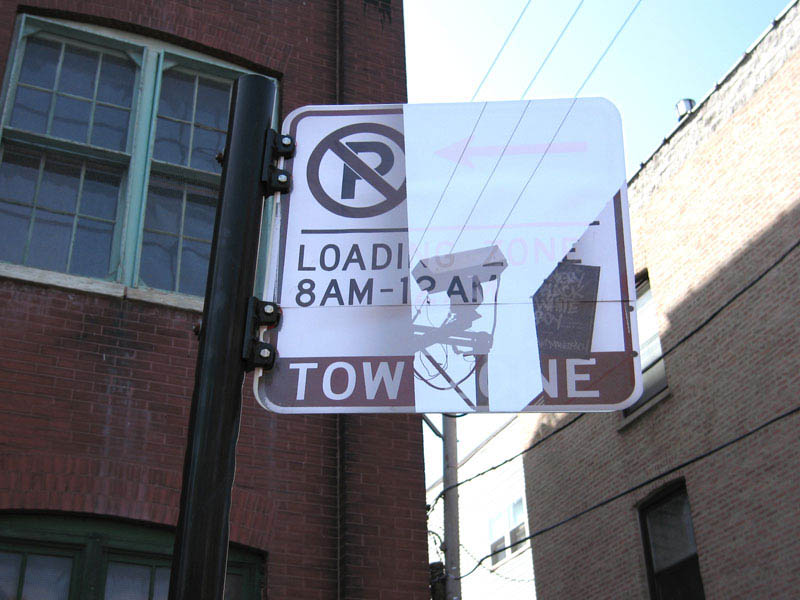 street sign pasted with photo of background so it looks transparent
