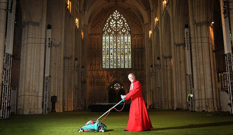 archbishop mowing the grass inside knave of york minster cathedral