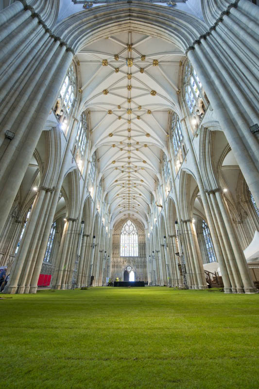 low angle shot of the york minster cathedral floor covered entirely in real grass