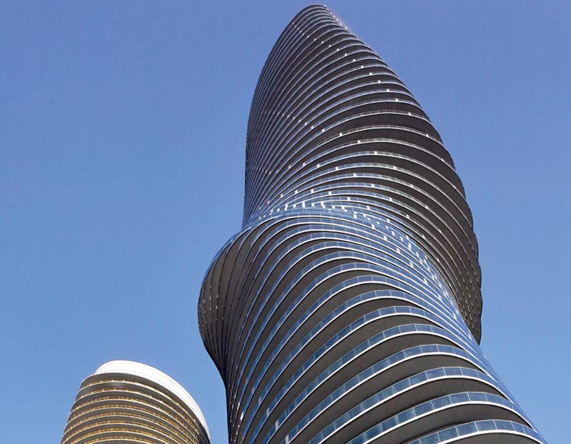 looking skyward at the marilyn monroe absolute condo tower in mississauga canada by mad architects