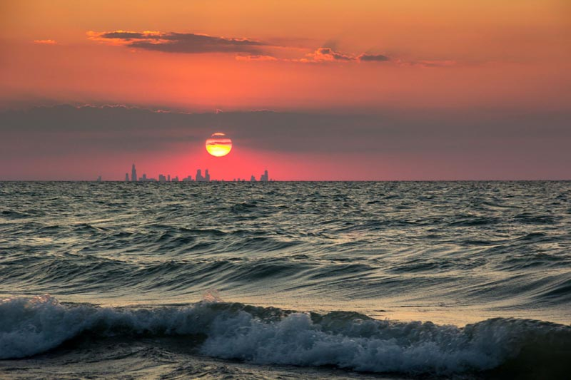 chicago skyline from indiana sunset across water The Top 100 Pictures of the Day for 2012