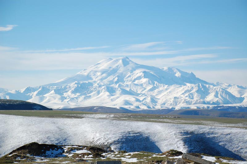 photo from afar of mount ebrus the highest point in europe