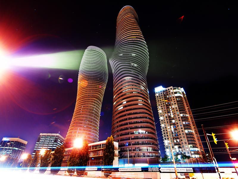 night shot of the marilyn monroe absolute towers in mississauga by mad architects