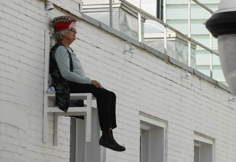 old people sitting in chairs high above ground in montreal angie heisl 10 Elderly People Suspended High Above the Streets of Montreal