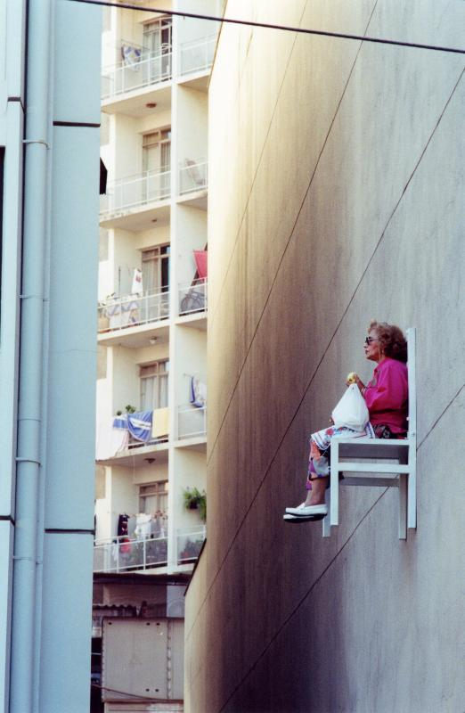 old people sitting in chairs high above ground in montreal angie heisl 5 Elderly People Suspended High Above the Streets of Montreal