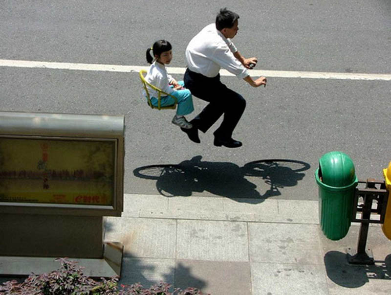 people riding invisible bikes by zhao huasen 2 This Interactive Street Art in Malaysia is Brilliant