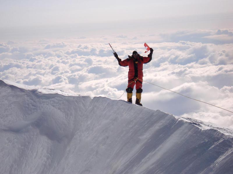 climber reaches the summit of mt mckinley