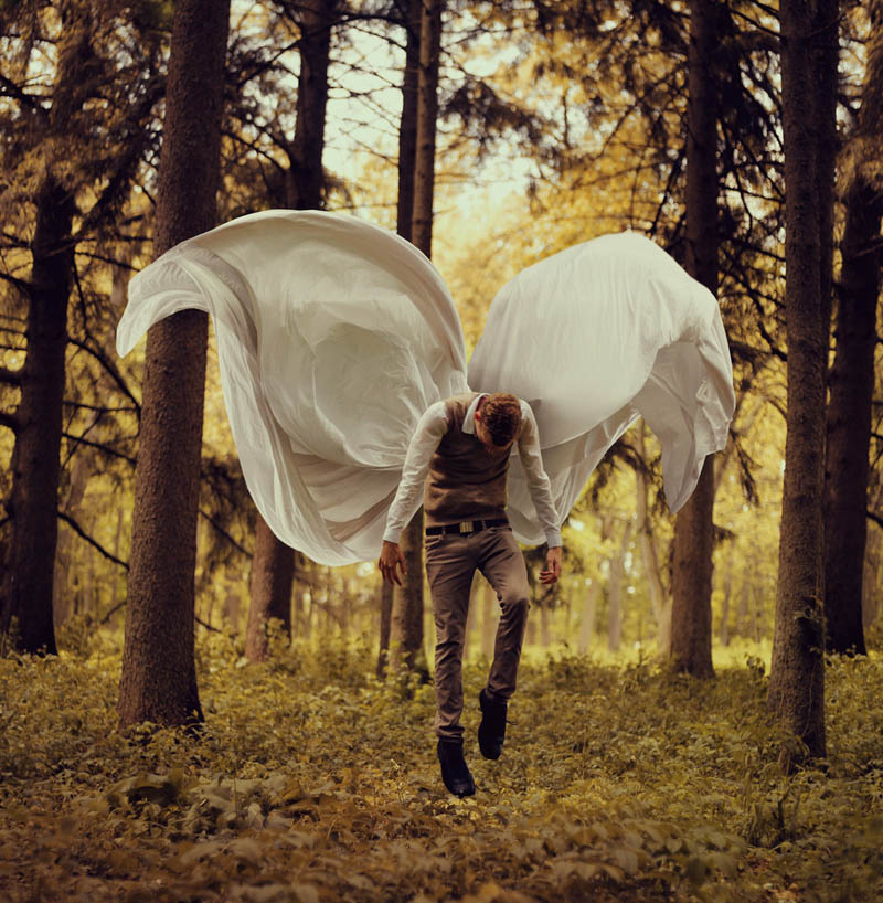 kyle thompson in forest with draped wings floating