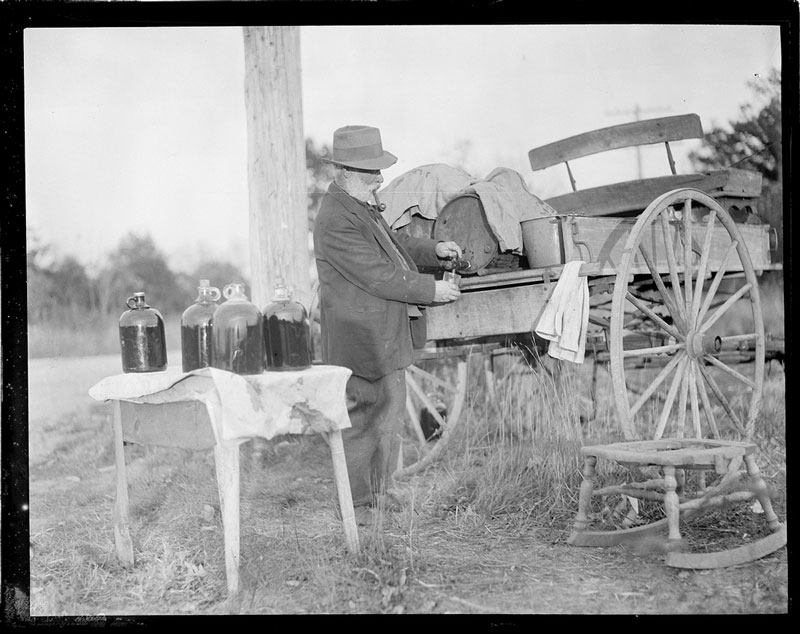 Man operates still of liquor out of the back of a carriage