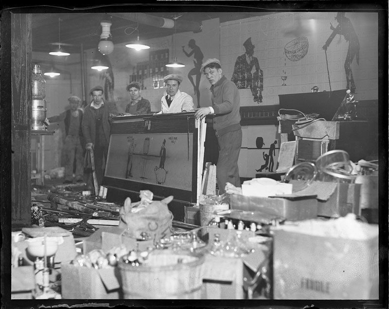 officers Dismantling a speakeasy after a raid