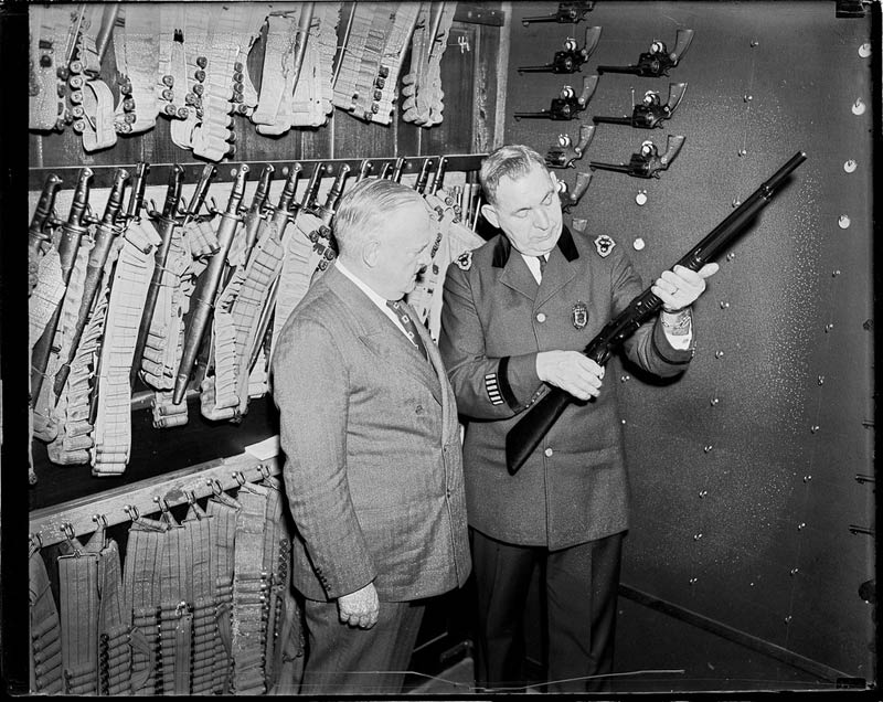 police commissioner and superintendent at police headquarters checking out weapons