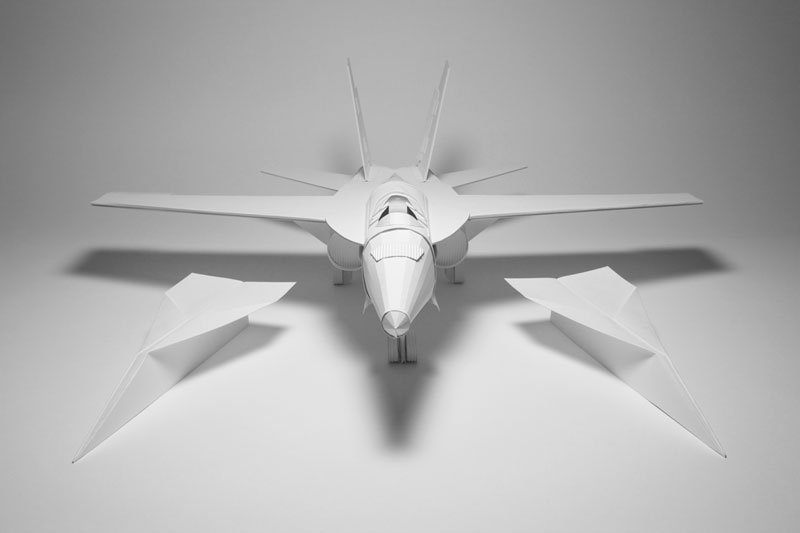 paper fighter jet beside paper airplanes kyle bean Inventive Hand Crafted Art by Kyle Bean