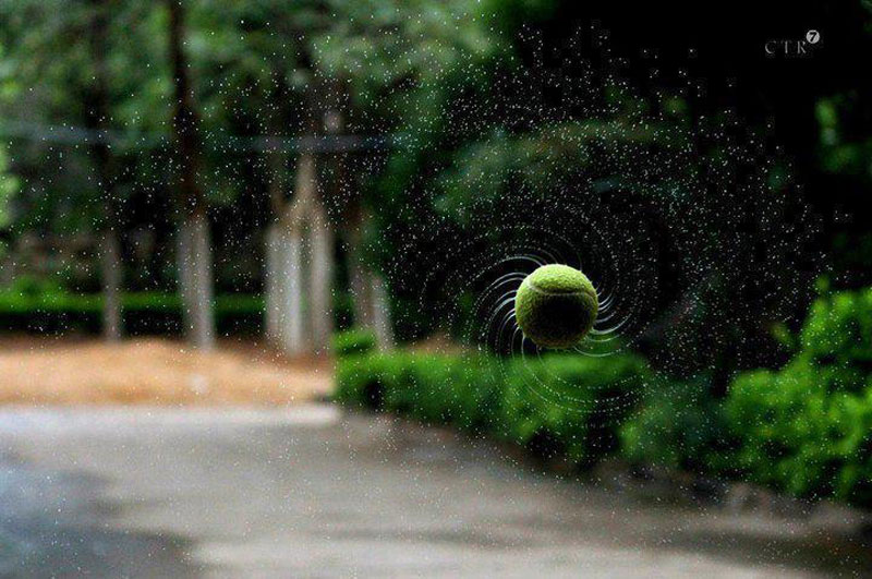 tennis ball spiral spinning water droplets Picture of the Day: Top Spin