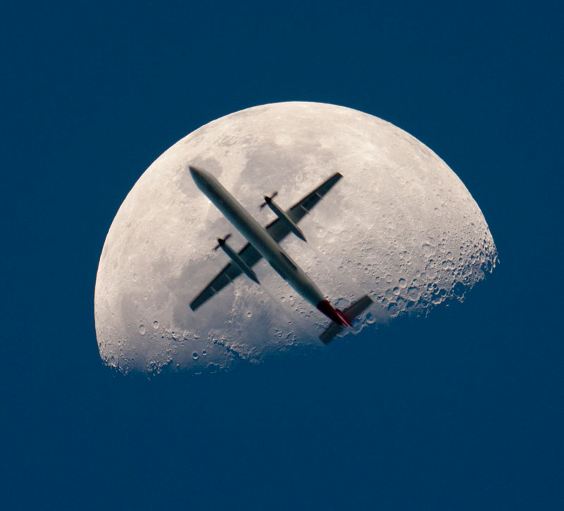 airplane passing the mooon perfect timing The Top 100 Pictures of the Day for 2012