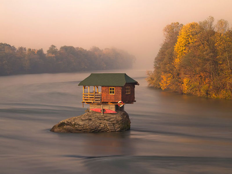 little house on rock in the middle of a river in serbia The Top 100 Pictures of the Day for 2012