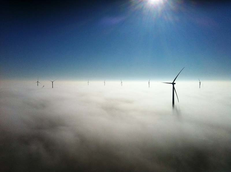 wind turbines above the fog Picture of the Day: Turbines Above the Fog