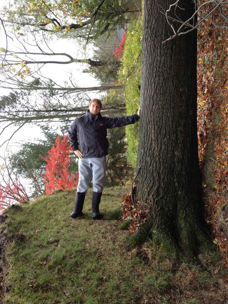 posing with uprooted tree horizontally upright Picture of the Day: Horizontally Upright